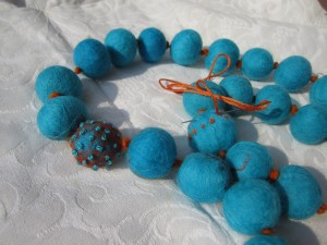 Necklace of felt balls with embroidery added